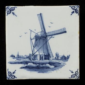 Tegel van keramiek, tinglazuur, voorstellende een landschap gemaakt in Makkum door Tichelaar  ca. 1974