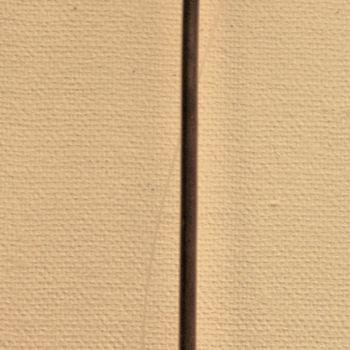 Gietlepel van ijzer aan lange steel met gaatjes.