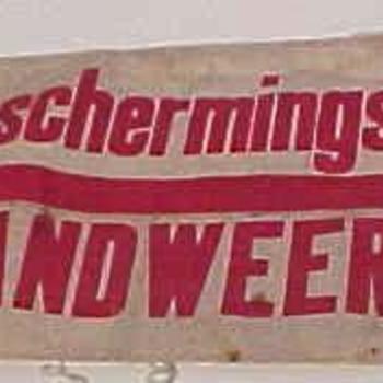 tekstarmband luchtberschermingsdienst en brandweer. Periode 1940-1945.