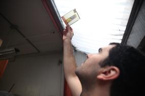 Artstor's Ian McDermott inspecting a transparency | Artstor | Photo: Marin Watts