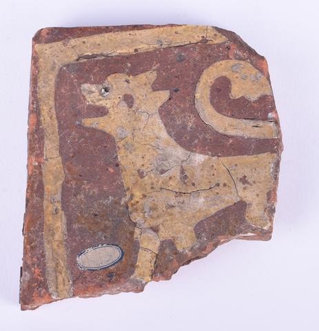 tegelfragment van vloertegel met afbeelding van dier