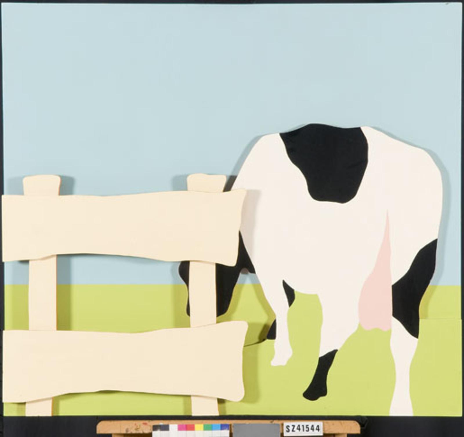Koe bij hek