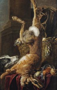 Een hond bij een dode haas en een mand met gevogelte