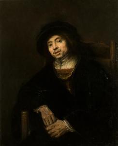 Portret van een zittende jonge man