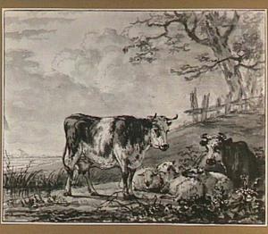 Koeien en schapen aan een oever