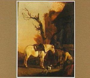 Een ruiter met zijn paard rustend voor een herberg
