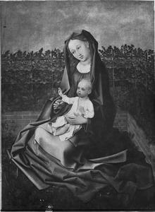 Maria met kind in een omsloten tuin
