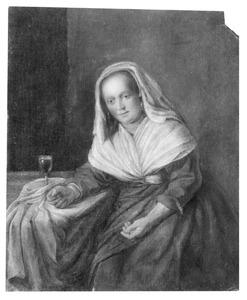 Jonge vrouw zittend aan een tafel met daarop een glas wijn, in haar hand een muntstuk