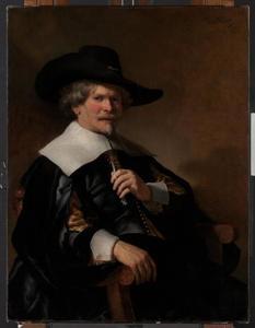 Portret van een man gezeten in een leunstoel