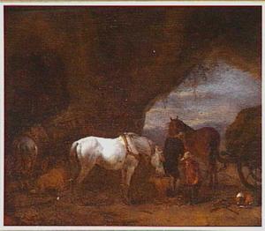 Stal in een grot met uitgespannen trekpaarden