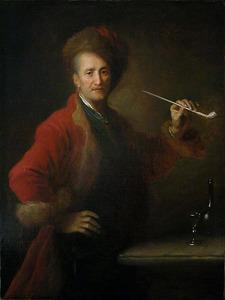 Portret van een man in Pools kostuum met een pijp in de hand