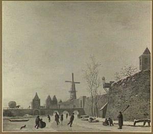 Gezicht op de Tolsteegpoort te Utrecht met omgeving in de winter