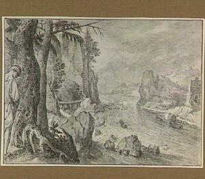 Rotsachtig rivierlandschap met plassende man