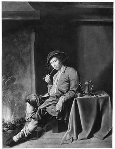 Rokende jonge man bij het haardvuur