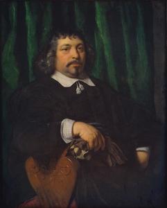 Portret van een man zittend op een schabel