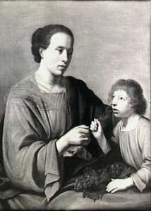 Een jongetje drinkt uit een glas dat wordt vastgehouden door een vrouw