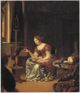 Een jonge vrouw die een papagaai voert