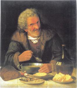 Oude man tijdens het eten