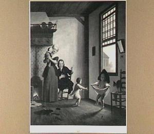 Man, vrouw en drie kinderen in een interieur