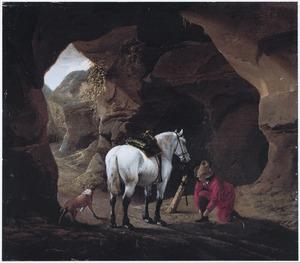 Afgestegen ruiter in een grot