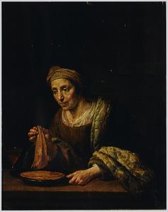 Vrouw met pannekoeken en een glas wijn
