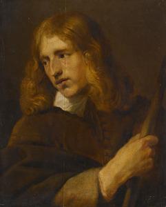 Portret van een jonge man met een stok
