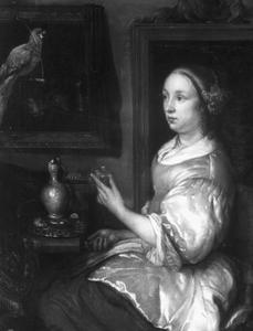 Vrouw met glas wijn en papegaai