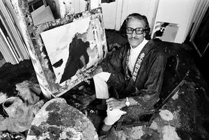 Portret van Eugène Brands aan het werk
