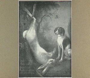 Hond bewaakt een geschoten haas