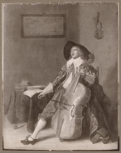 Musicerende jonge man in een interieur