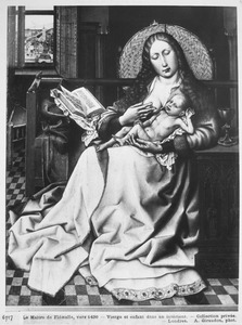 Maria met kind voor het haardscherm