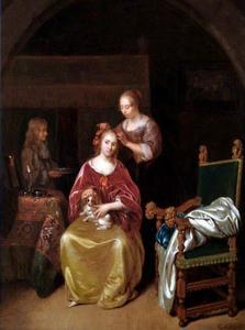 Interieur met een jonge vrouw aan haar toilet