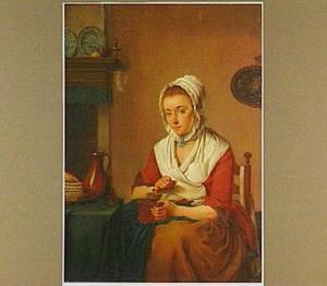 Jonge vrouw aan het koffie malen