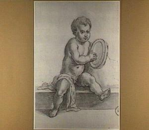 Zittend naakt jongetje met tamboerijn
