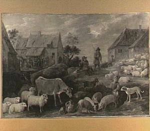 Herders met vee bij een dorp