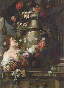 Jonge vrouw versiert een terracotta tuinvaas met een bloemslinger