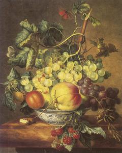 Vruchtenstilleven in een porseleinen kom op een marmeren blad
