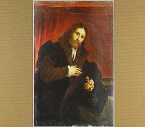 Portret van een man met een vogelpoot in zijn linkerhand
