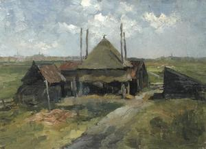 Haystack and farm sheds in a field