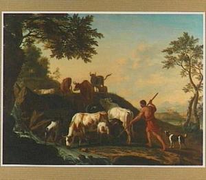 Veedrijver met vee bij een stroomversnelling