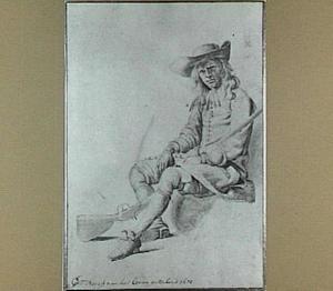 Een zittende jongeman met een geweer