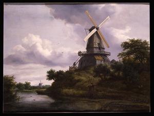 Landschap met windmolen aan een rivier