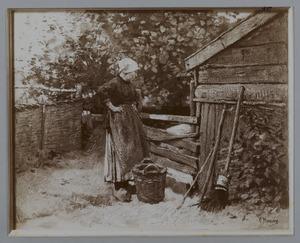 Boerin bij varkenskot