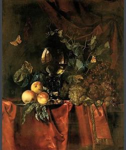 Stilleven van vruchten en een roemer op een tafelkleed