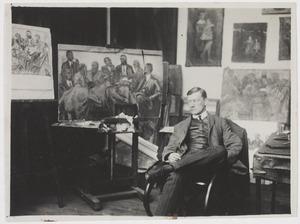 Herbert Fiedler zittend  in zijn atelier