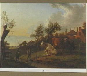 Twee jongens met een hengel bij een weide met koeien
