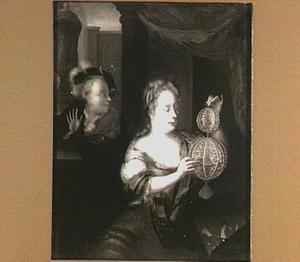 Vrouw maakt een papieren globe