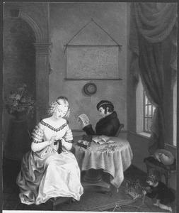 Salon met een jong gezin met bezigheden rond een tafel