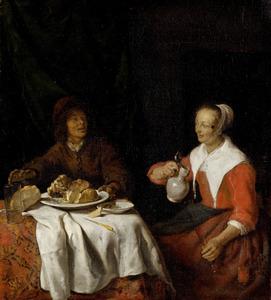 Man en vrouw aan de maaltijd