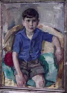 Portret van een jongen zittend in rotanstoel